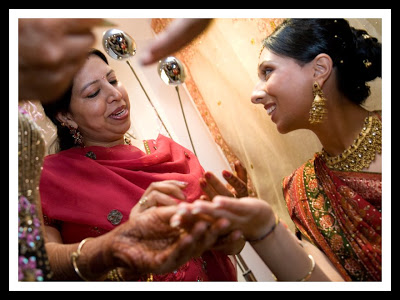 applying henna at mehndi party